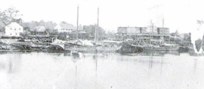 Lumber schooner being loaded at Goos' sawmill, Ca. 1880 (Courtesy Archives and Special Collections at Frazar Memorial Library, McNeese State University)