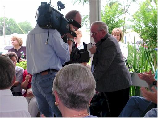 Mr. Ed J. Reitsma pins medal on W. T. Block